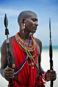 Maasai Warrior Standing on Beach - Gay Adventures